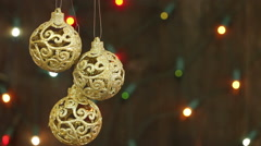 Delicate golden balls on the background of garlands blinking. Christmas backgrou Stock Footage