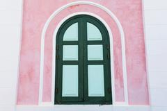 Classic wooden window on pink wall Stock Photos