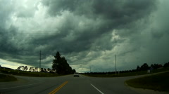 POV driving into storm with severe weather and black clouds Stock Footage