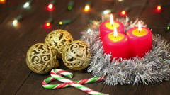 Burning candles and Christmas decorations on a tree background. Stock Footage