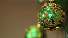 green ball with sparkles on a Christmas tree - stock footage