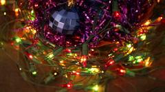 Christmas balls and garland flashing tangled on the floor Stock Footage