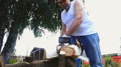 Elderly man in protective glasses sawing birch log Stock Footage