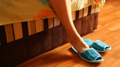 Woman beautiful legs with slippers in the morning as a wake up concept Stock Footage