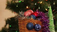 Christmas toys in the background of spruce with a garland flashing - stock footage
