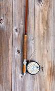 Vintage fly rod and reel on rustic wooden boards Stock Photos
