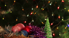 Christmas toys in the background of spruce with a garland flashing Stock Footage