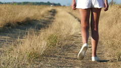 Slow motion.  Beautiful Female  legs  go  on  dirt road Stock Footage