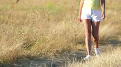 Slow motion.  Beautiful Female sexual  legs  go  on  dirt road Stock Footage