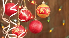 Red Christmas balls hanging on strings. Flashing a garland blurred background Stock Footage
