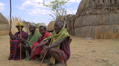 Ethiopian Elders From A Tribe Within The Omo Valley Sitting in Their Village Stock Footage
