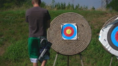 Target Archery: Young Archer Walks in Slow Motion Toward Target Stock Footage