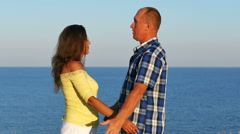 Slow motion. Adult  loving couple embraces on sea background Stock Footage