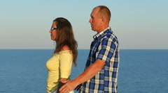 Slow motion. Adult  loving couple embraces on sea background. Focus change Stock Footage