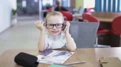 Office kid talking on phone Stock Footage