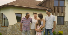 Family, happiness, generation, home and people concept - happy family standing Stock Footage