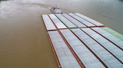 Fly over of large barge on Mississippi River Stock Footage