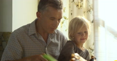 Close-up of grandfather and grandkid eating healthy meal together Stock Footage