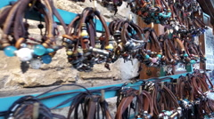 Various colorful leather bracelets on sale at a street market in Nesebar, Bul Stock Footage