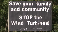 Signs of protest against renewable energy wind turbines Stock Footage
