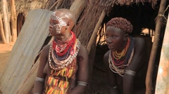 Medium Shot of Two Omo Valley Tribe Members In Their Hut Stock Footage