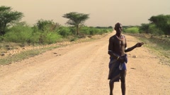 Tribal Man From Within The Omo Valley Walking Across A Rural Road Stock Footage