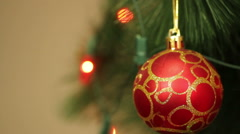 Red ball on the Christmas tree with blinking garlands Stock Footage