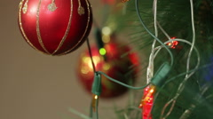 Red balls on a Christmas tree with blinking garlands Stock Footage