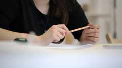 Close-up view of woman holding pencil and talking Stock Footage