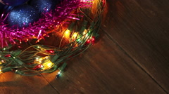 Blue balls in a wicker basket and garland flashing. Christmas background Stock Footage