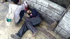 Man fainted lying on street sidewalk pavement Stock Footage