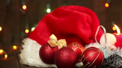 Hat of Santa Claus and Christmas tree decorations Stock Footage
