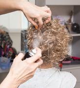 Female hair lacquer in a beauty salon Stock Photos