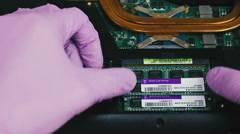 Removing and installing RAM in the laptop Stock Footage