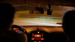 Careless driving at night, driver speeding, making crazy turns, street racing Stock Footage