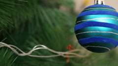 The blue ball is swinging on a Christmas tree. Stock Footage