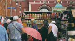 MOSCOW, RUSSIA - RUSSIA - JULE 22, 2016: Tourists buying souvenirs on Red Square Stock Footage