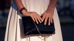 Fashionable girl with a black bag in her hands Stock Footage