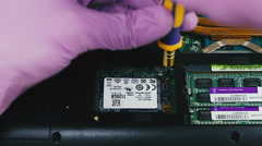 Removing and installing mSATA SSD in the laptop Stock Footage