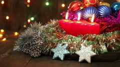 Burning candles and Christmas decorations. Christmas still life Stock Footage