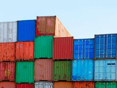 Stack of Cargo Containers at the Docks ready for Shipping Stock Photos