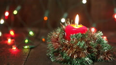 Burning Christmas candle. Flashing blurred background. Christmas decorations Stock Footage