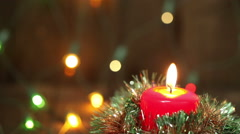 Burning Christmas candle. Flashing blurred background. Christmas decorations Stock Footage