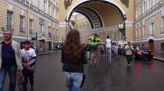 Tourist girl walk to Palace Square happily smile and point at beautiful arch Stock Footage