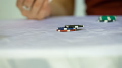 Casino chips on white table Stock Footage