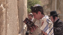 JERUSALEM, ISRAEL - 12 JUN 2016: pray at the Wailing Wall Jewish shrine in Stock Footage