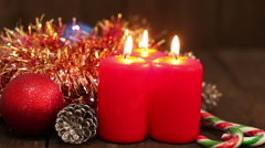 Christmas decorations. Burning candles and toys on the background of garlands bl Stock Footage