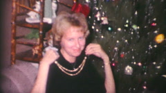 Pretty Lady Shows Off Christmas Gift-1962 Vintage 8mm film Stock Footage