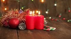 Christmas decorations. Burning candles and toys on the background of garlands bl - stock footage