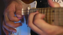 A man playing on electric guitar pentatonic scale in the recording studio close- Stock Footage
